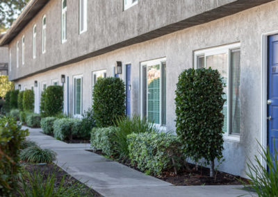 Walkway in front of walkway blue door
