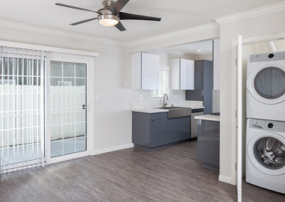 Laundry/dining/kitchen area
